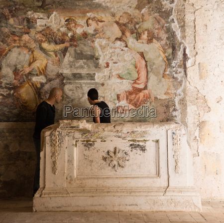man and woman looking at fresco