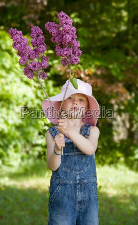 boy holding lilac blossom