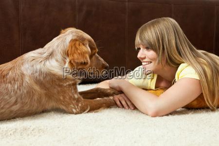 young woman and dog lying on