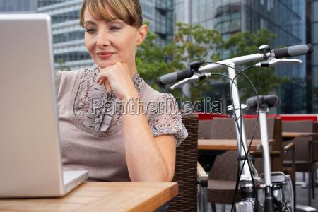 business woman using laptop outside