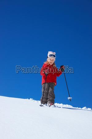 little girl skiing on mountain