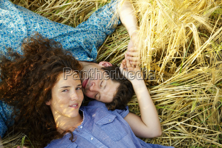 couple laying down in a wheat