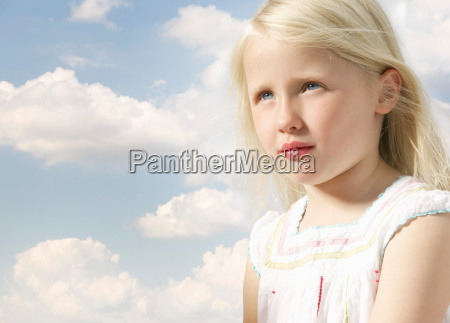 girl looking up with sky background
