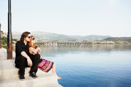 couple sitting by the sea