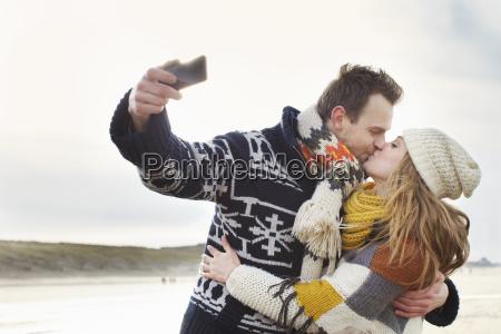 mid adult couple taking self portrait