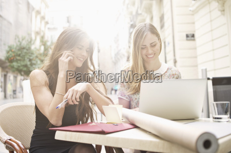 two young female friends taking a