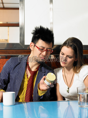 young man and woman reading ingredients