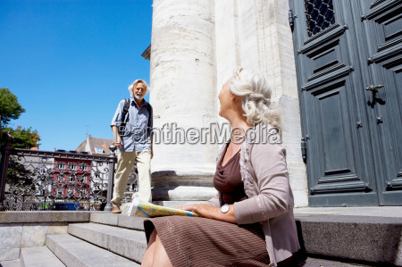 woman looking over at man