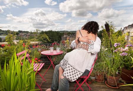 couple sitting on balcony