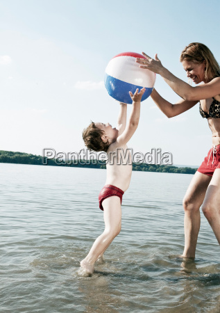 child jumping with mother