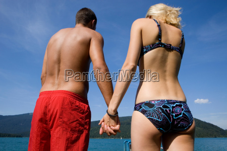 a couple holding hands by a