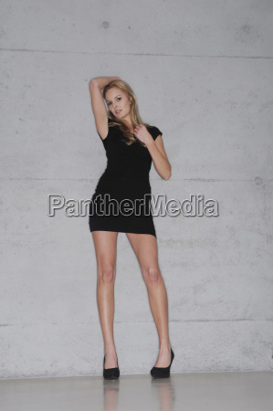woman wearing short black dress