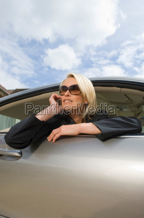 business woman on phone in car