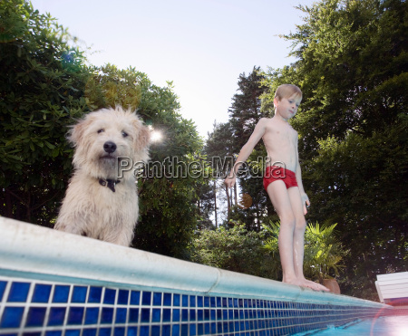 boy with dog about to jump