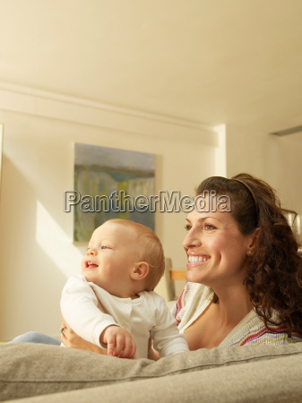 mother holding baby side view