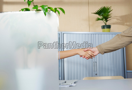 man and woman shaking hands at