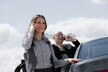 man and woman near car on