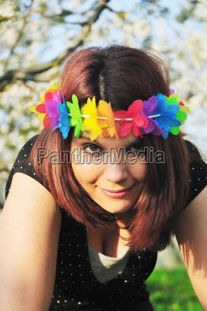 woman wearing colorful lei on head