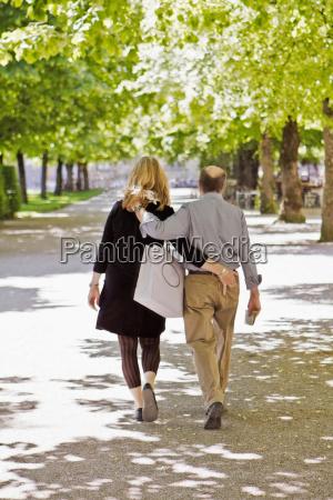 older couple walking in park together