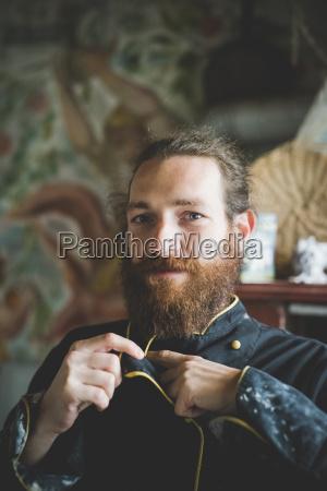 portrait of bearded mid adult man