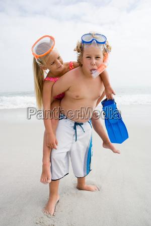 girl and boy on beach