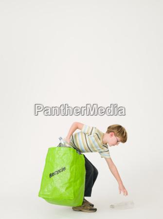 boy recycling bottles