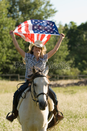 a girl holding the american flag