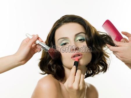 young, woman, having, hair, and, makeup - 18618876