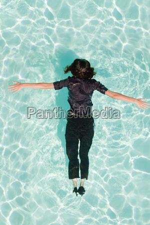 woman face down in swimming pool