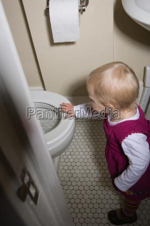 little girl by toilet