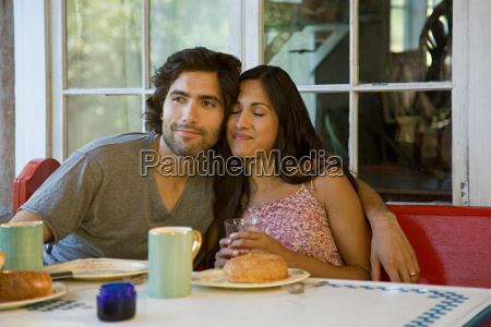 couple relaxing at breakfast