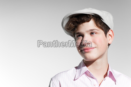 boy wearing a flat cap