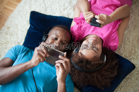 man and woman playing on handheld