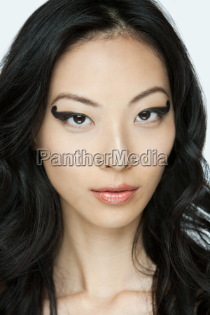 young woman with black eye makeup