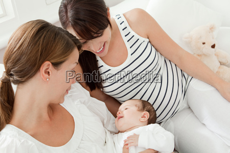 mother with baby girl and pregnant