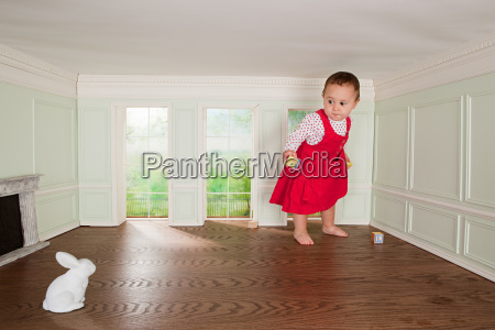 toddler girl in a tiny room