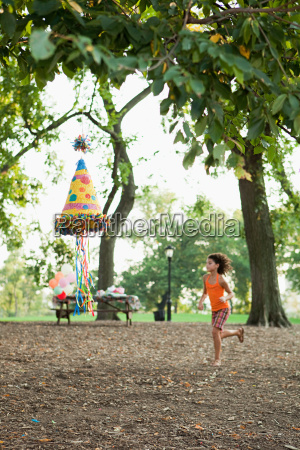 girl at birthday party running past