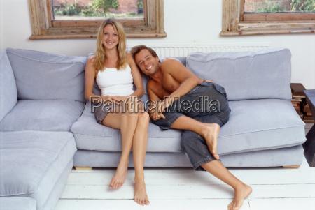 couple sitting together on sofa