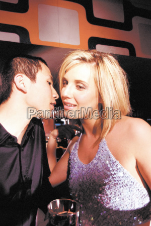 man and woman together in nightclub