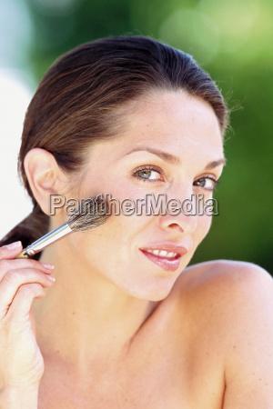 woman, applying, makeup - 18754656