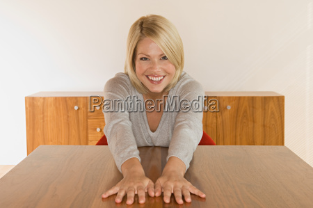 woman with hands on table