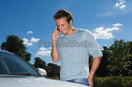 man in mobile phone by his
