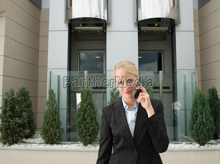 a businesswoman using a cell phone