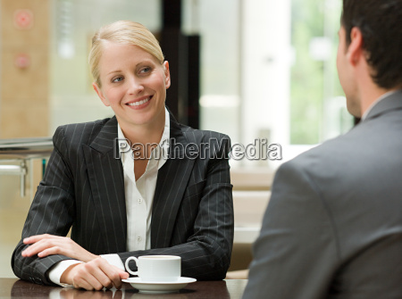 business people face to face in