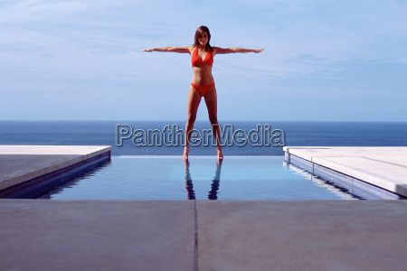 young woman at swimming pool by