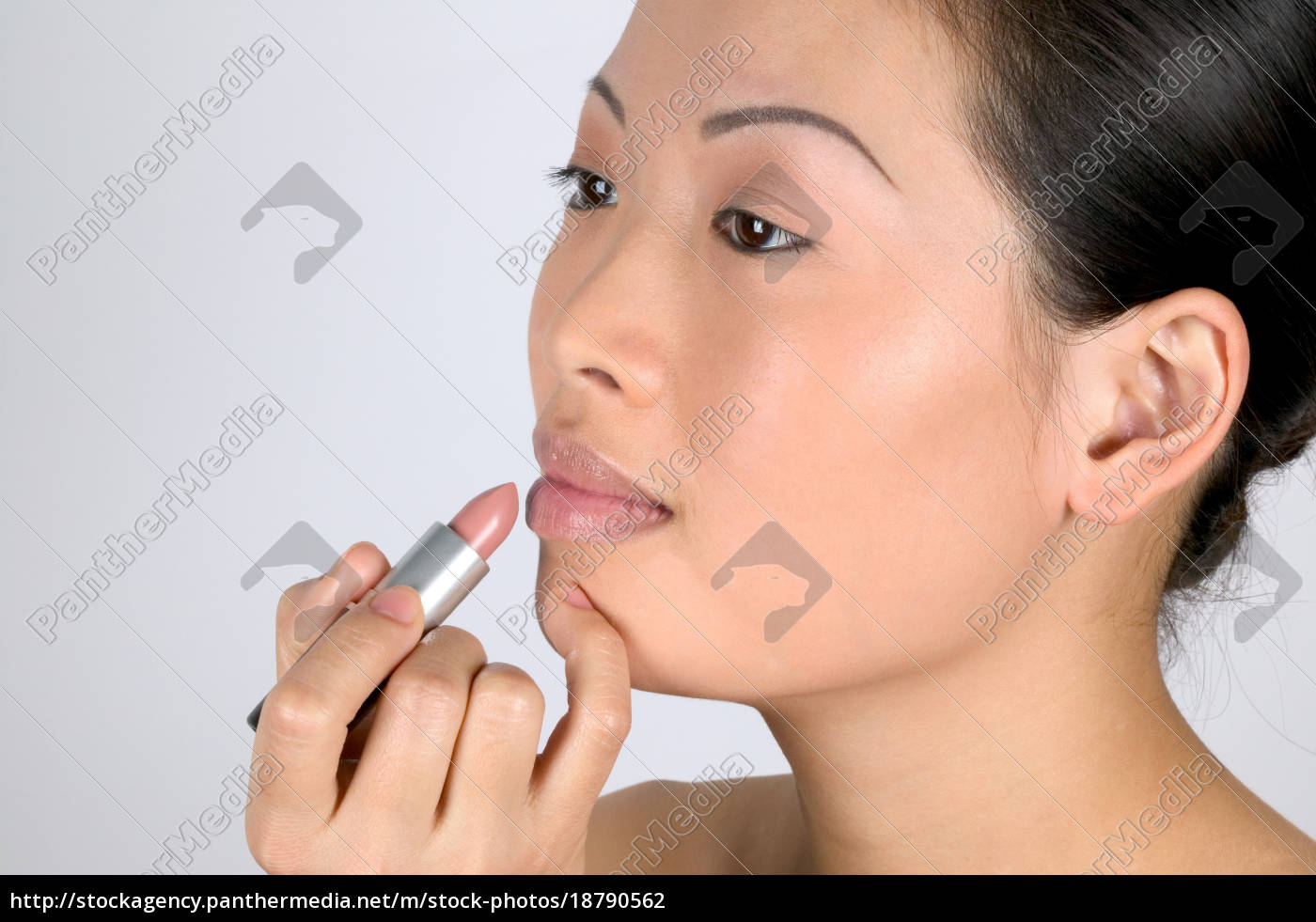 woman, applying, lipstick - 18790562