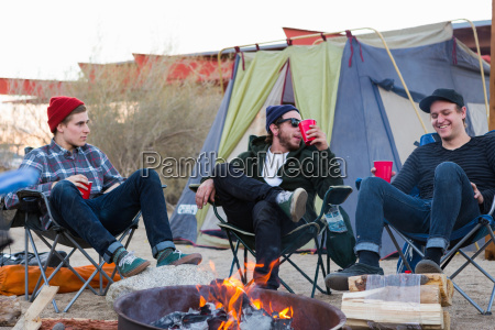 three young male friends sitting chatting