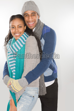 young couple wearing winter clothes