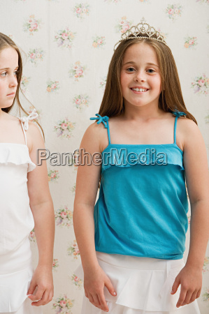 girl looking jealously at her sister