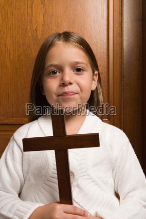 girl holding a crucifix